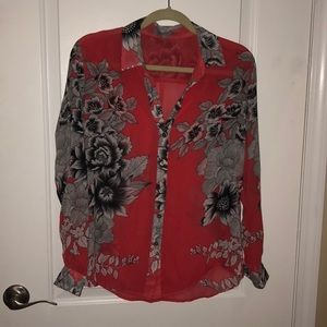 Red blouse with black flowers